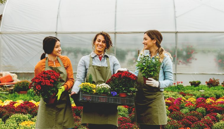 Smiling florists in greenhouse
