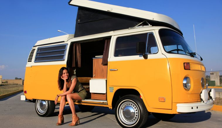 sexy woman sitting in a camper bus - roadtrip